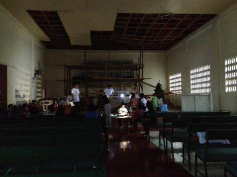 Without electricity, the BGNi medical team worked into the night, seeing patients using video lights at Cantihing Church of Christ in Leyte