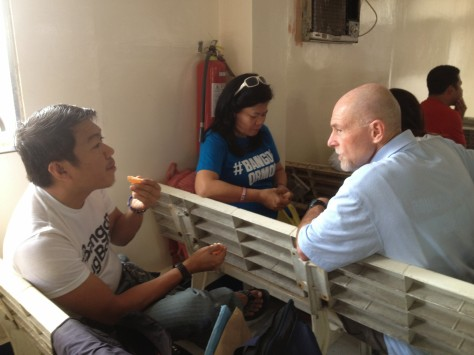 Rick Wolford talks with Dr. Titus Bantiles and his wife Dolly (center) while in Ormoc City, Leyte.